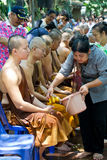 People celebrate Songkran by pouring water for buddhist priest Royalty Free Stock Photography