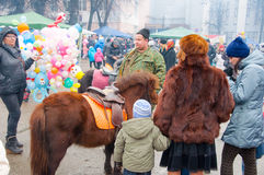 People celebrate traditional Russian holiday called Maslenitsa in Moscow. Stock Photo