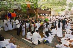 People celebrate Vesak religious festival in a Buddhist temple in Colombo, Sri Lanka. Stock Photos