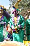 People celebrated crazily in Mardi Gras parade. Royalty Free Stock Photos