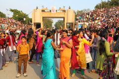 People celebrating at the border flag lowering ceremony. Evening flag lowering ceremony at India and Pakistan Border in Wagah, which partitioned the Indian Stock Photo