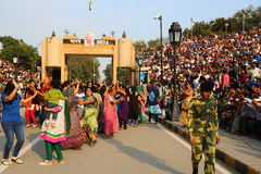People celebrating at the border flag lowering ceremony. Evening flag lowering ceremony at India and Pakistan Border in Wagah, which partitioned the Indian Royalty Free Stock Images