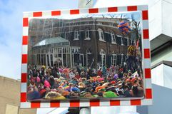 People celebrating Carnaval trough safety mirror. Stock Photo