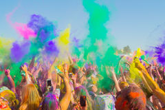 People celebrating during the color throw. Stock Photos