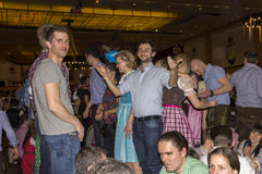 People celebrating on the famous Munich Strong Beer Festival. Stock Photography