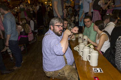 People celebrating on the famous Munich Strong Beer Festival. Stock Photos