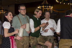 People celebrating on the famous Munich Strong Beer Festival. Stock Images