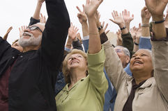 People Celebrating With Hands Raised Royalty Free Stock Photography