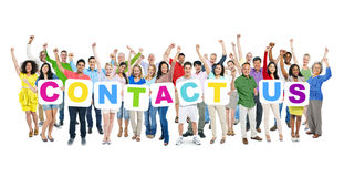 People Celebrating and Holding Word Contact Us.  Stock Photos
