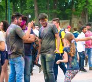 People celebrating Holi color festival in Kharkiv, Ukraine. Royalty Free Stock Photo