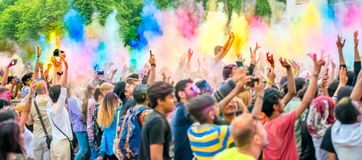 People celebrating Holi color festival in Kharkiv, Ukraine. Royalty Free Stock Images