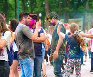 People celebrating Holi color festival in Kharkiv, Ukraine. Stock Photo