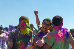 People celebrating Holi Festival of Colors. Stock Image