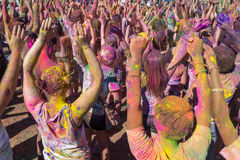 People celebrating Holi Festival of Colors. Stock Photos