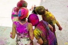People celebrating holi looking at tablet, Rishkesh, India. Royalty Free Stock Photos