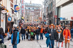 People celebrating at Koninginnedag 2013. Koninginnedag or Queens Day was a national holiday in the Kingdom of the Netherlands until 2013. Celebrated on 30 April Stock Photo