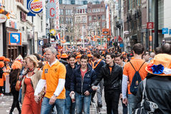 People celebrating at Koninginnedag 2013. Koninginnedag or Queens Day was a national holiday in the Kingdom of the Netherlands until 2013. Celebrated on 30 April Stock Image