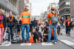 People celebrating at Koninginnedag 2013 Stock Image