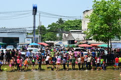 People celebrating Songkran festival beside of canal Stock Images