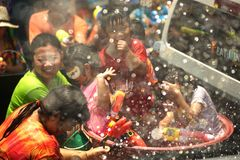 People celebrating the Songkran festival or Thai New Year`s Festival. Ayutthaya , Thailand - April 13 , 2016 : Unidentified crowd playfully splashing water fun Stock Images