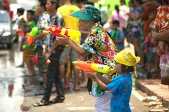 People celebrating the Songkran festival or Thai New Year`s festival. Ayutthaya , Thailand - April 13 , 2016 : Unidentified crowd playfully splashing water fun Royalty Free Stock Photos