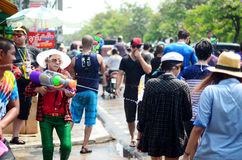 People celebrating Songkran (Thai new year / water festival) in the streets. CHIANG MAI, THAILAND - APRIL 13 : People celebrating Songkran (Thai new year / water Royalty Free Stock Photo