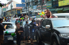 People celebrating Songkran (Thai new year / water festival) in the streets by throwing water. CHIANG MAI, THAILAND - APRIL 13 : People celebrating Songkran ( Royalty Free Stock Images