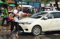 People celebrating Songkran (Thai new year / water festival) in the streets by throwing water Stock Images