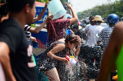 People celebrating Songkran (Thai new year / water festival) in the streets by throwing water. CHIANG MAI, THAILAND - APRIL 13 : People celebrating Songkran ( Stock Photo