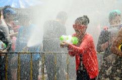 People celebrating Songkran or water festival. CHIANG MAI, THAILAND - APRIL 15 : People celebrating Songkran or water festival in the streets by throwing water stock photos