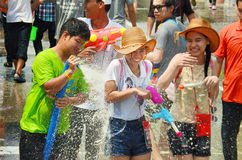 People celebrating Songkran or water festival. CHIANG MAI, THAILAND - APRIL 15 : People celebrating Songkran or water festival in the streets by throwing water Stock Images
