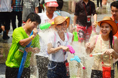 People celebrating Songkran or water festival. CHIANG MAI, THAILAND - APRIL 15 : People celebrating Songkran or water festival in the streets by throwing water Royalty Free Stock Photo