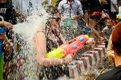 People celebrating Songkran or water festival. CHIANG MAI, THAILAND - APRIL 15 : People celebrating Songkran or water festival in the streets by throwing water stock photography