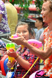 People celebrating Songkran water festival Stock Photo
