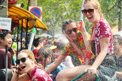 People celebrating Songkran water festival. CHIANG MAI, THAILAND - APRIL 15 : People celebrating Songkran water festival in the streets by throwing water at each Royalty Free Stock Image
