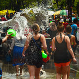 People celebrating Songkran or water festival in the streets Stock Image