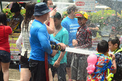 People celebrating Songkran or water festival in the streets Royalty Free Stock Photos