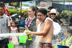 People celebrating Songkran or water festival in the streets Stock Images