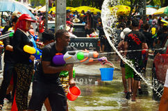 People celebrating Songkran or water festival in the streets by throwing water Stock Photography