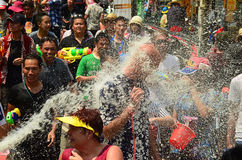 People celebrating Songkran or water festival in the streets by throwing water at each other on. CHIANG MAI, THAILAND - APRIL 15 : People celebrating Songkran or Royalty Free Stock Photos