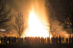People celebration around big huge traditional fire event. Big huge traditional fire. Burning of witches in a bonfire. Profane rites in Bavaria, Germany. Alps Royalty Free Stock Photo