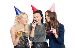 Happy women with party caps hugging Royalty Free Stock Photography
