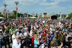 People during the celebration of Victory Day are watching a concert at the Exhibition of Economic Achievements. MOSCOW, RUSSIA - MAY 9, 2016:People during the Royalty Free Stock Photography
