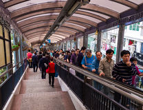 People on Central–Mid-Levels escalator of Hong Kong. People using the Central–Mid-Levels escalator in Hong Kong island the longest escalator system in Stock Photography