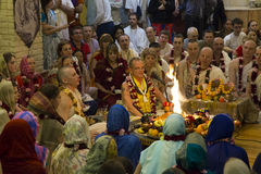 People at the ceremony in Hare Krishna Temple. Moscow, Russia, 8 May 2017 stock photography