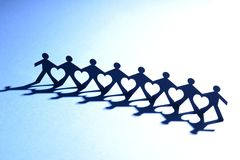 People in chain with heart between Royalty Free Stock Photography