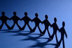 People in chain with heart between Stock Image