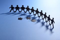 People in chain with jigsaw puzzle Stock Photography
