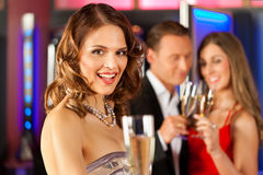 People with champagne in a bar Royalty Free Stock Image