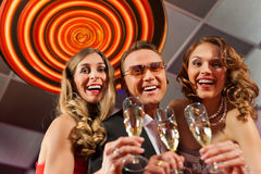 People with champagne in a bar Royalty Free Stock Photos